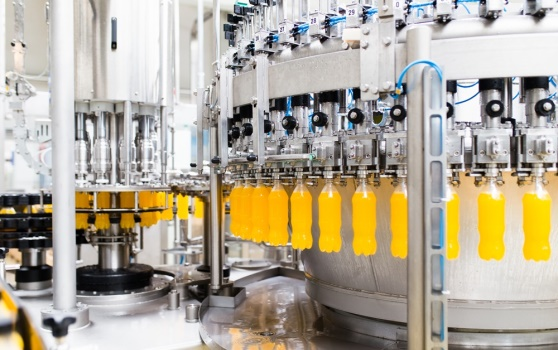 Filling line fast batch dosing on orange bottles